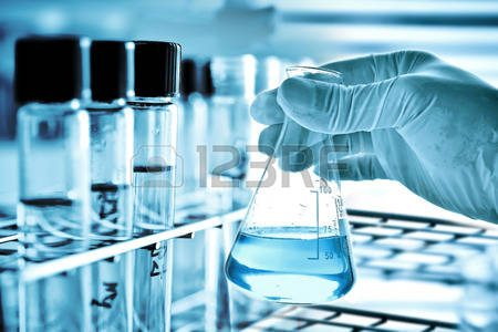 45720416-flask-in-scientist-hand-and-laboratory-glassware-background
